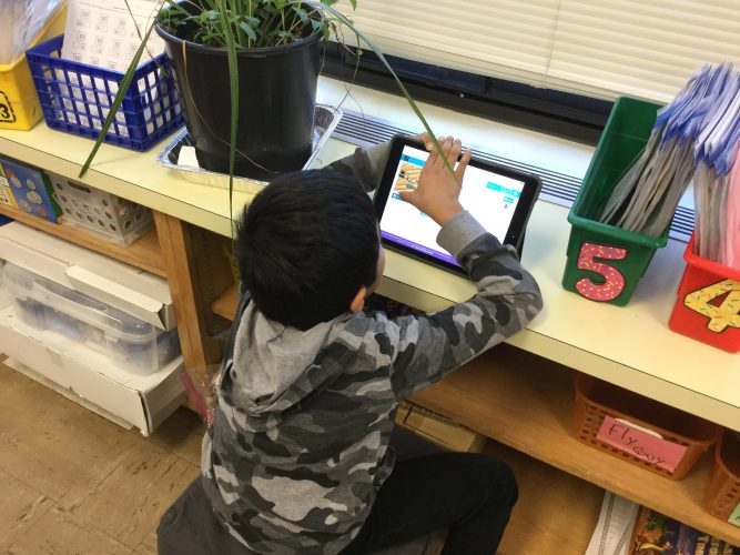Second graders practice their coding skills in Mrs. Gomez's classroom.